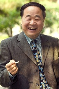 Chinese writer Mo Yan laughs as he holds a cigarette during the International Strindberg Conference in Beijing